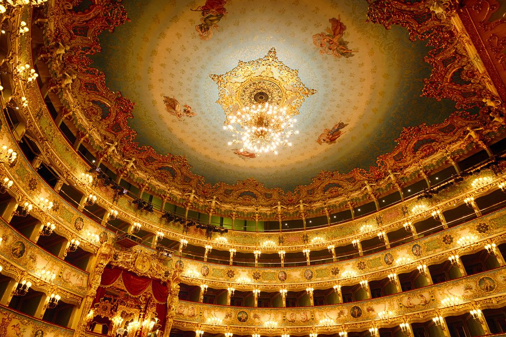 watch opera at an opera house in Italy